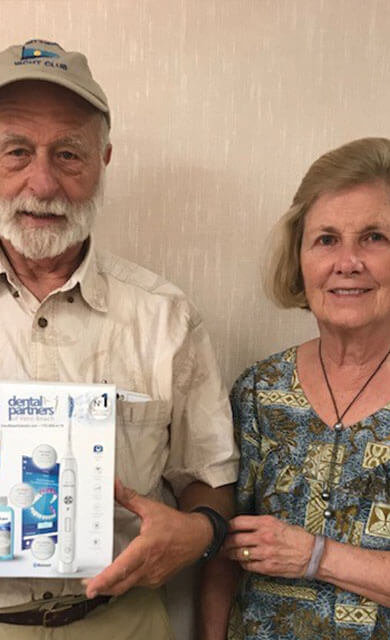 man and woman receive patient appreciation gift