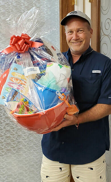 man receives patient appreciation basket