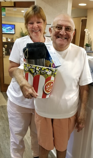 two patients receive gifts at movie night giveaway